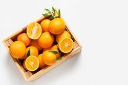 Box with tasty oranges on white background