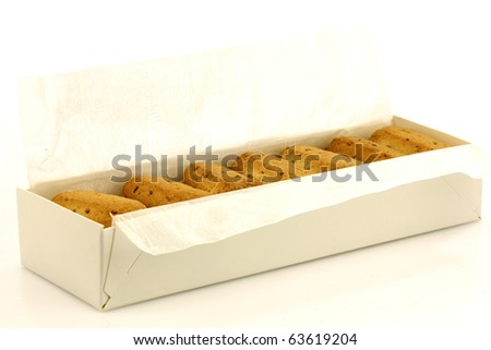 """box with traditional Dutch cookies(Friesland)  called """"Fryske dumkes"""" on a white background - stock photo"""