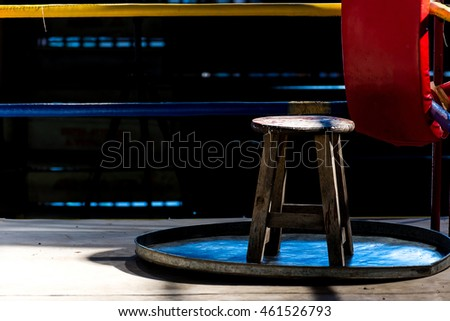Boxer corner in fight club for boxer waiting drinking water between fight round