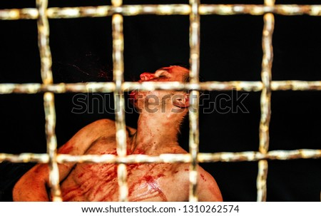 Boxer fights in a cage, a bloody face