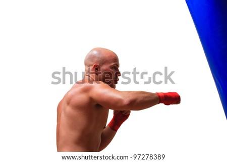 Boxer hitting the sandbag hard isolated