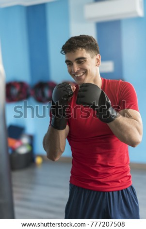 boxer in gym training with...