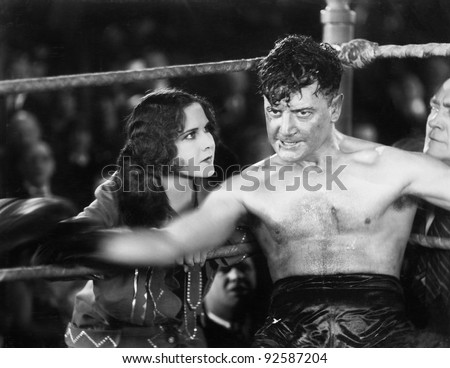 Boxer sitting in the corner of a boxing ring