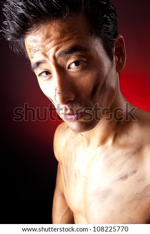 Boxer street fighter asian six-pack on Black Background