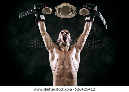 Boxer with Champion belt celebrating flawless victory isolated on black background with copy Space.. #626425412