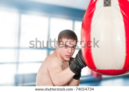 Boxer with punch bag in action