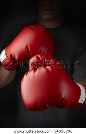 Boxer with red boxing gloves about to throw a punch