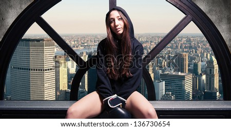 Boxer woman portrait relaxing in dressing room with New York skyline in the background.