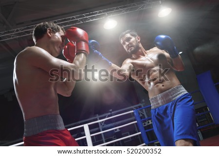 Boxers fighting in a boxing ring