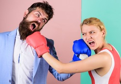 Boxers fighting in gloves. Domination concept. Gender equality. Man and woman boxing fight. Couple in love competing in boxing. Conflict concept. Gender battle. Gender equal rights. Family quarrel.