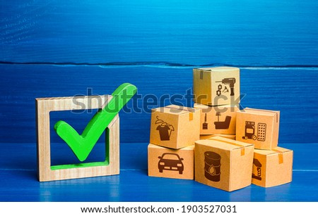 Boxes and green check mark. Free Trade Area and Economic Preferences Agreement. Verification of imported goods products. Quality control. Trade agreements. Available in stock. Import and Sale Permits. Zdjęcia stock ©