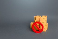 Boxes and prohibition symbol NO. Trade wars. A ban on the import of goods. Impossibility of transportation, oversupply. Shortage of goods. Sanctions and embargoes. Confiscation of contraband.