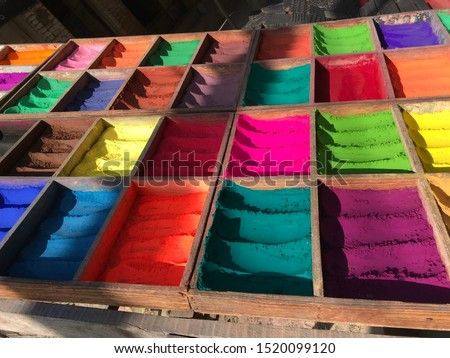 Boxes of bright coloured powder paint for Holi the Indian festival of colour and paint throwing, in Kathmandu, Nepal