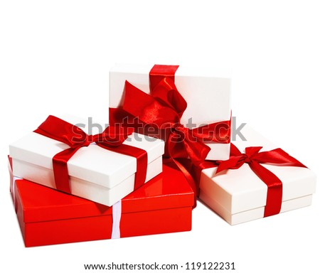Boxes tied with a ribbon bow. A gift for Christmas, Birthday, Wedding, or Valentine's day. Isolated on white