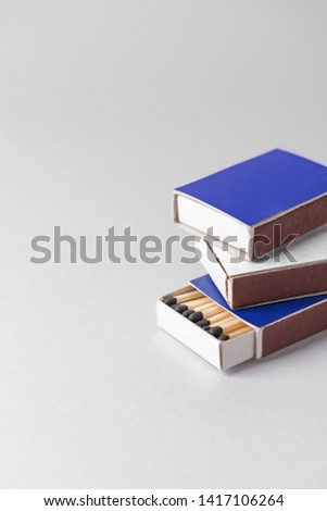 Boxes with matches on light background