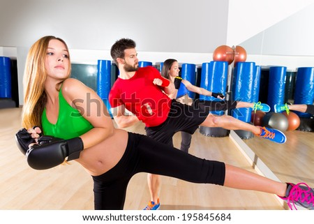 Boxing aerobox group low kick training at fitness gym mirror