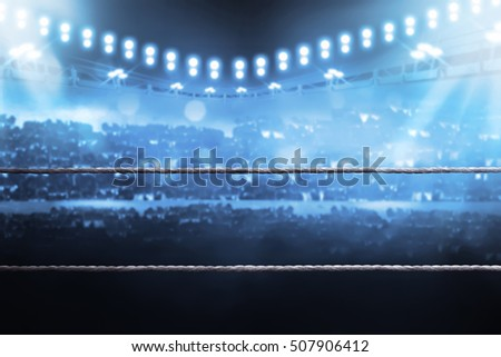 Boxing arena with blurred spectator and stadium light