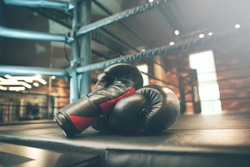 boxing glove on boxing ring in gym