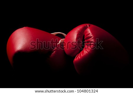 Boxing gloves against a black background
