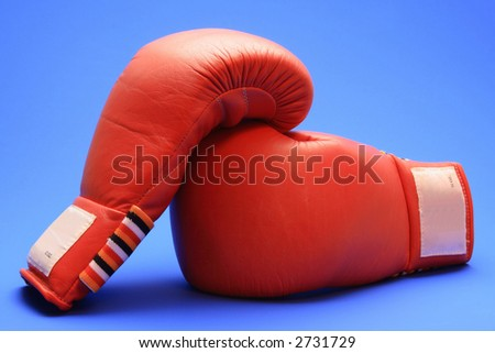 Boxing gloves on blue background - stock photo