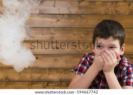 boy afraid of cigarette smoke...