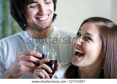 Boy and beautiful girl with wineglasses