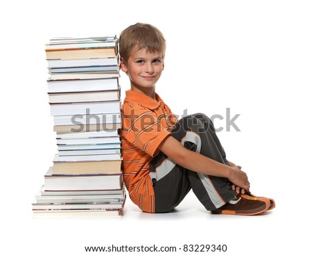Boy and books isolated on a white background