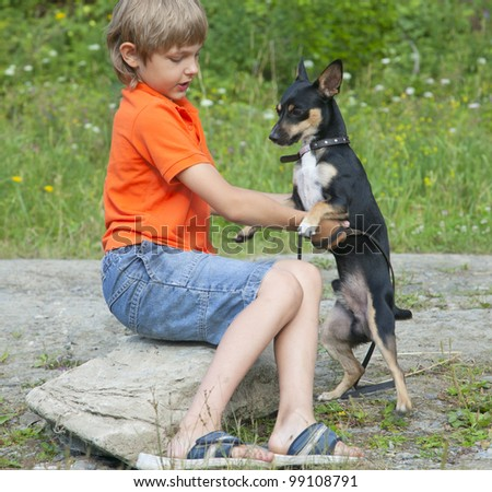 Boy and dog in nature. they are friends - stock photo