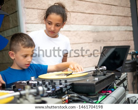 boy and girl boy mixing record on turntable #1461704198