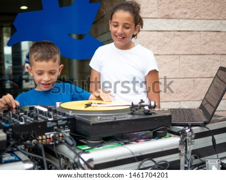 boy and girl boy mixing record on turntable #1461704201