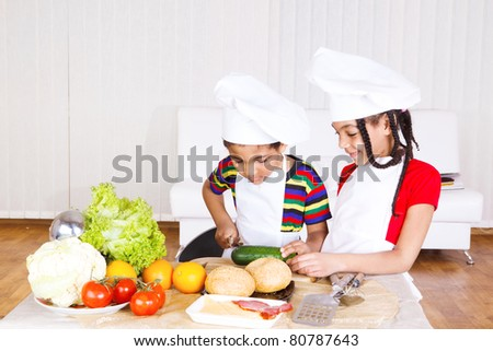 Boy and girl busy with cooking