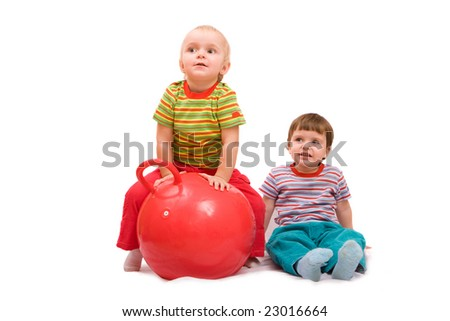 Boy and girl doing exercises with big red ball. Isolated on white