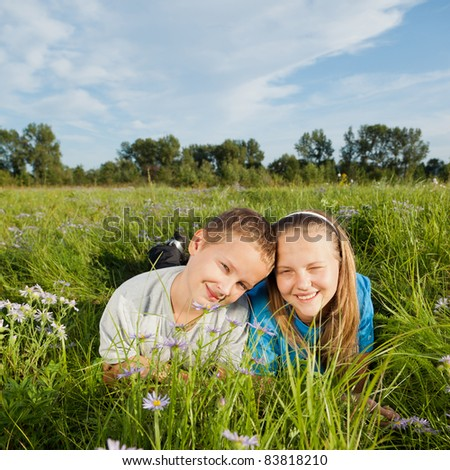 Boy and girl in grass