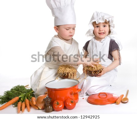 Boy and girl making a mess with spaghetti