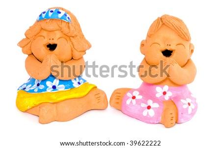Boy and girl of clay figurine - stock photo