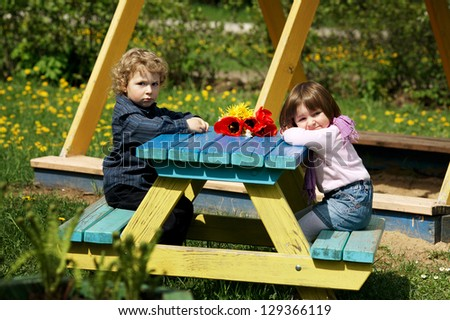 boy and girl on date on playground