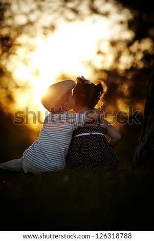boy and girl on sunset
