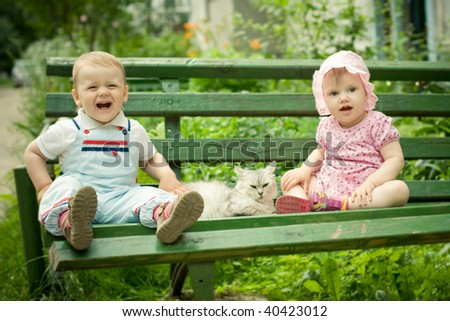 boy and girl on the bench in park