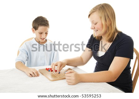 Boy and girl playing a game of Chinese checkers. Isolated on white.