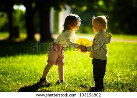 boy and girl playing with ball