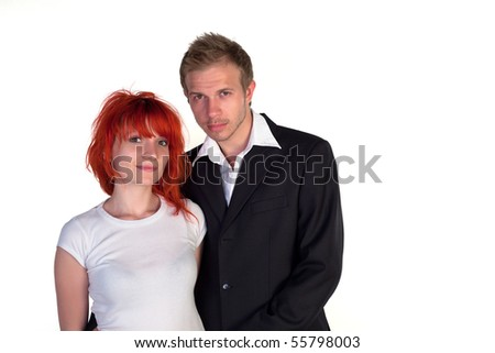 Boy and girl posing on a white background