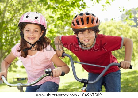 Boy and girl riding bikes
