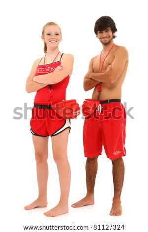Boy and girl teen lifeguards in uniform over white background smiling with clipping path. - stock photo