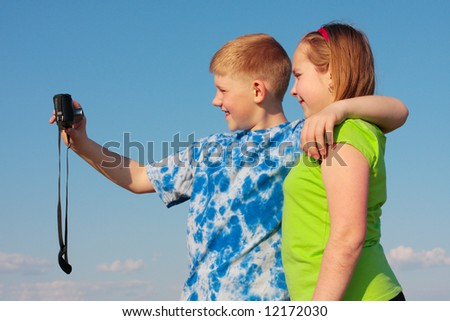 boy and girl with camera