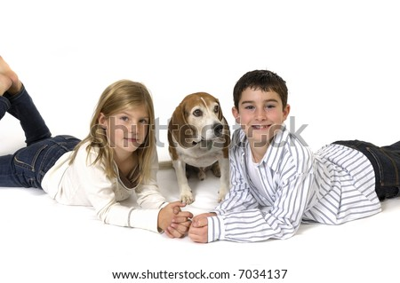 Boy and girl with pet dog.