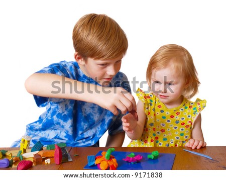 boy and girl with plasticine