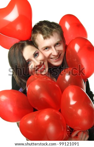 boy and girl with red balloons hearts