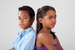 Boy and girl with stern faces