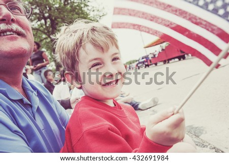 Boy and his father watching a parade