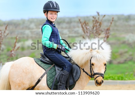 Boy and his Shetland pony